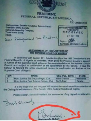 President Buhari called out for wrong spelling of his name on official document