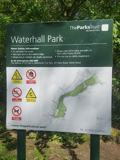 A sign in the Parks Trust Waterhall Park South Car park