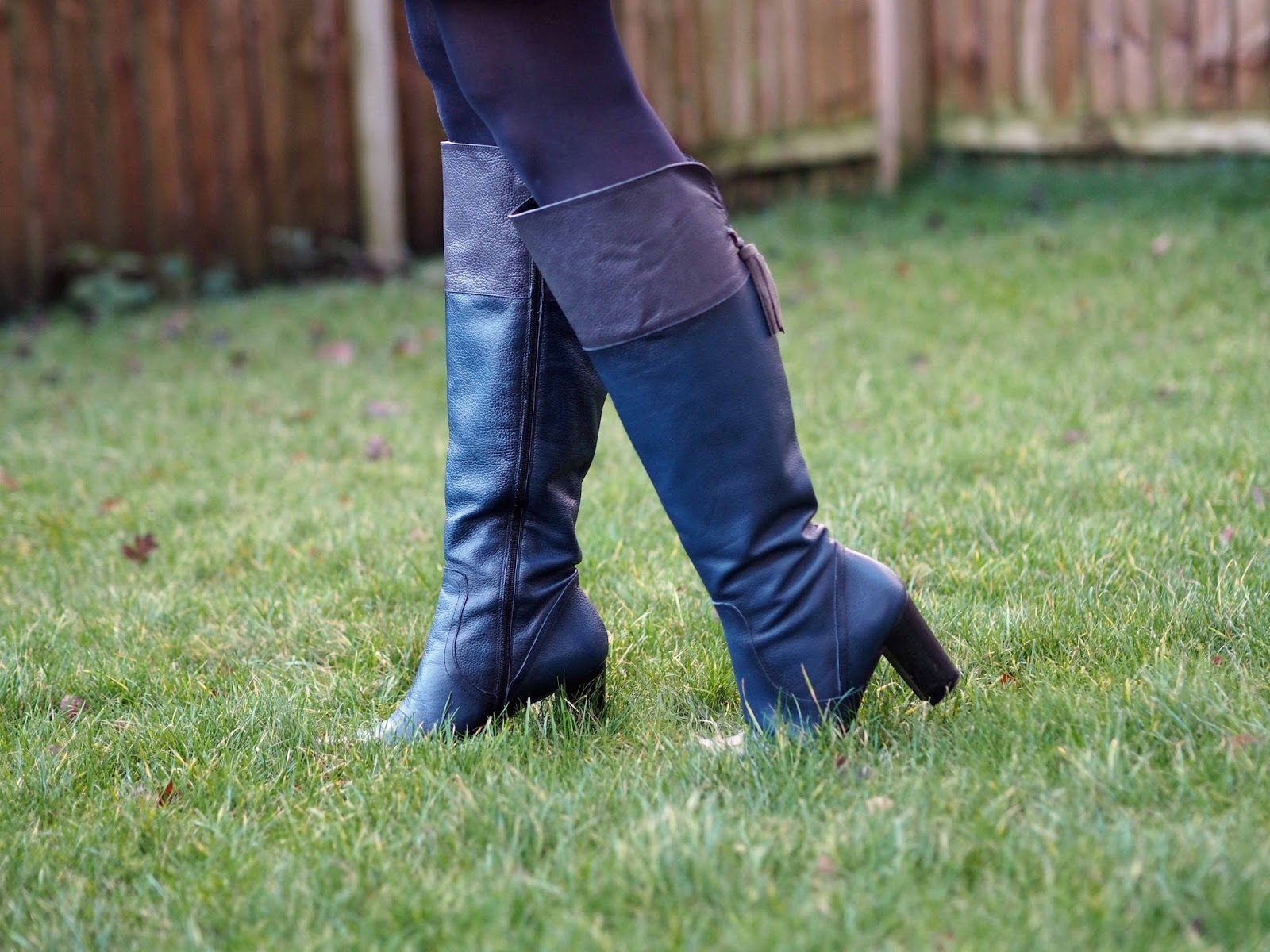 Kaleidoscope navy knee high leather boots with tassels