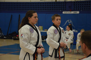 Teenage Taekwondo black belts using courage