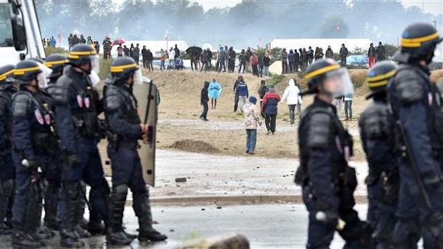 French police clash with refugees and human rights activists outside Calais camp