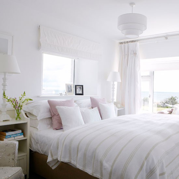Fresh White linens in country bedroom