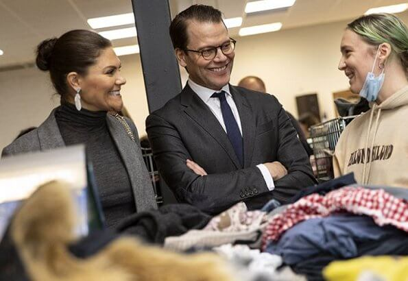 Crown Princess Victoria wore Erdem X H and M wool suit, Kreuger Jewellery summer feather earrings, Valentino shoulder bag. City Mission