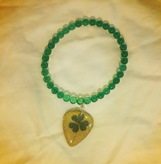 Guitar pick jewelry made with real clovers