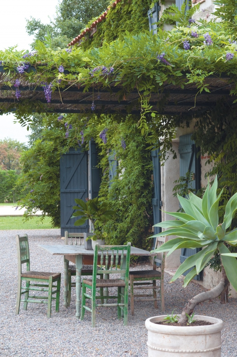 Decor inspiration: #Frenchfarmhouse gravel courtyard and pergola on Hello Lovely Studio #blueshutters #Provence