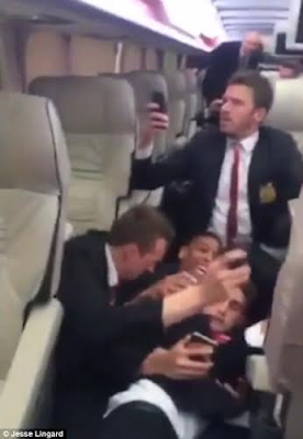 Watch Man U players react as team bus is attacked with bottles and stones by West Ham fans