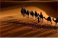 "<Imgsrc=""caravana-de-camellos-noche-Mohammed.jpg"" width = ""389"" height ""258"" border = ""0"" alt = ""Caravana de camellos"">"