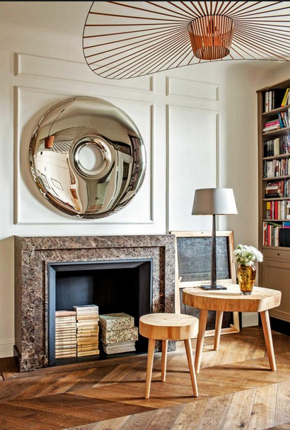 molding walls, fire place and convex mirror with vertigo lighting pendant