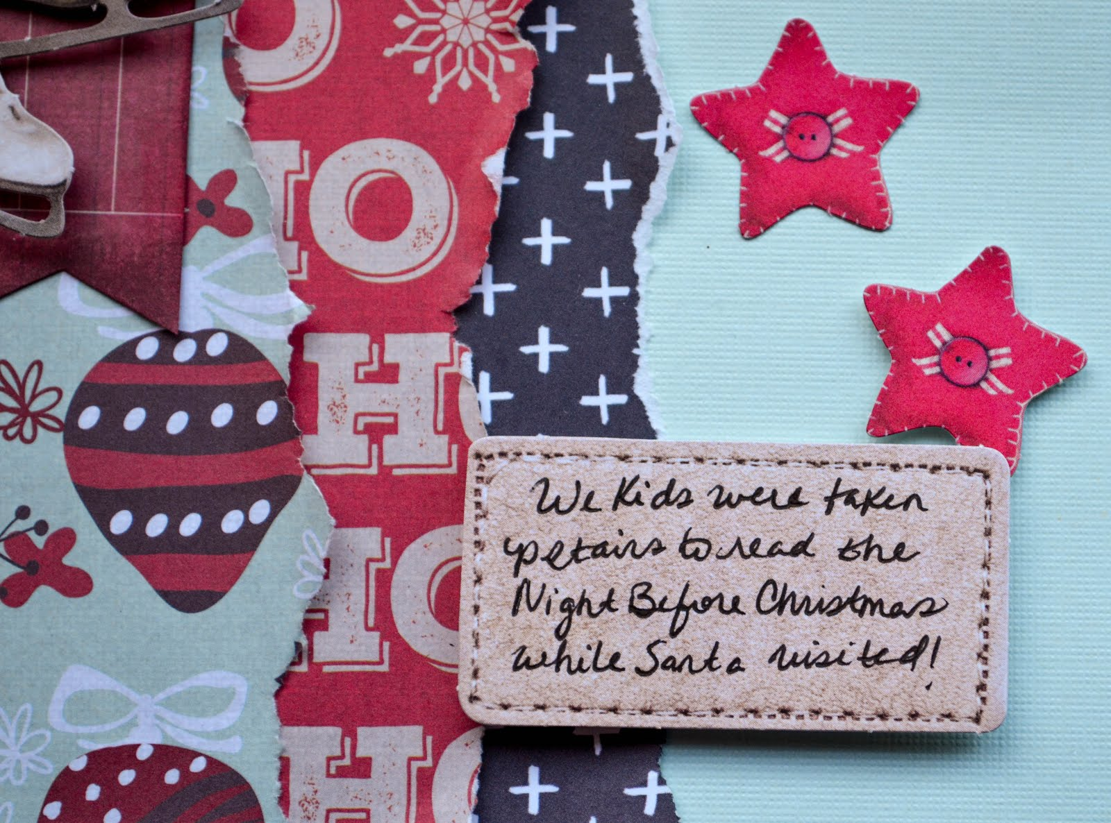 Christmas scrapbook layout in blue, red, green, and black with die cuts from Studio Light and baker's twine