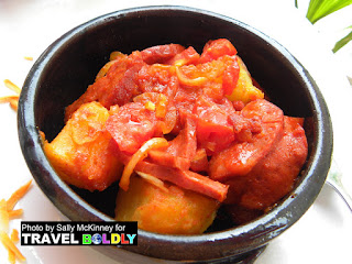 Spanish stew of sausages, potatoes, tomatoes and onions in Cuba - TravelBoldly.com