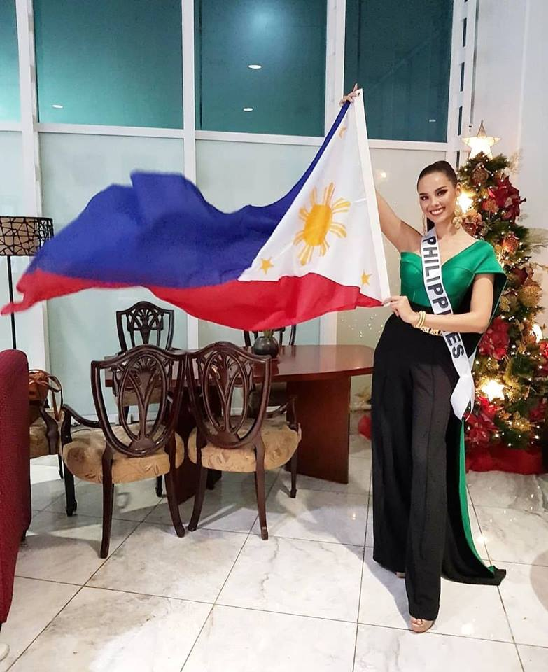 Catriona Gray wears an emerald jumpsuit made by Filipino designer