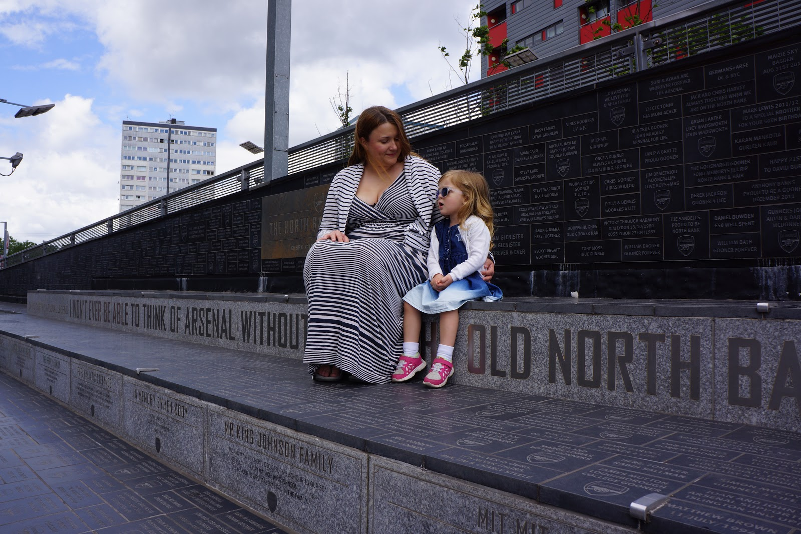 mum and daughter sitting on Arsenal Stadium steps