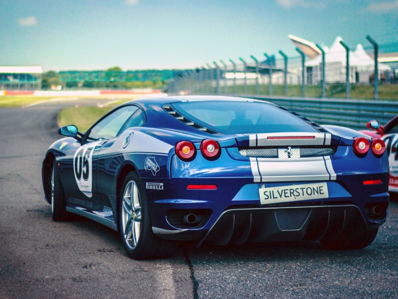 Download Silverstone Blue Silver Stripe Race Car on Track HD wallpaper. Click Visit page Button for More Images.