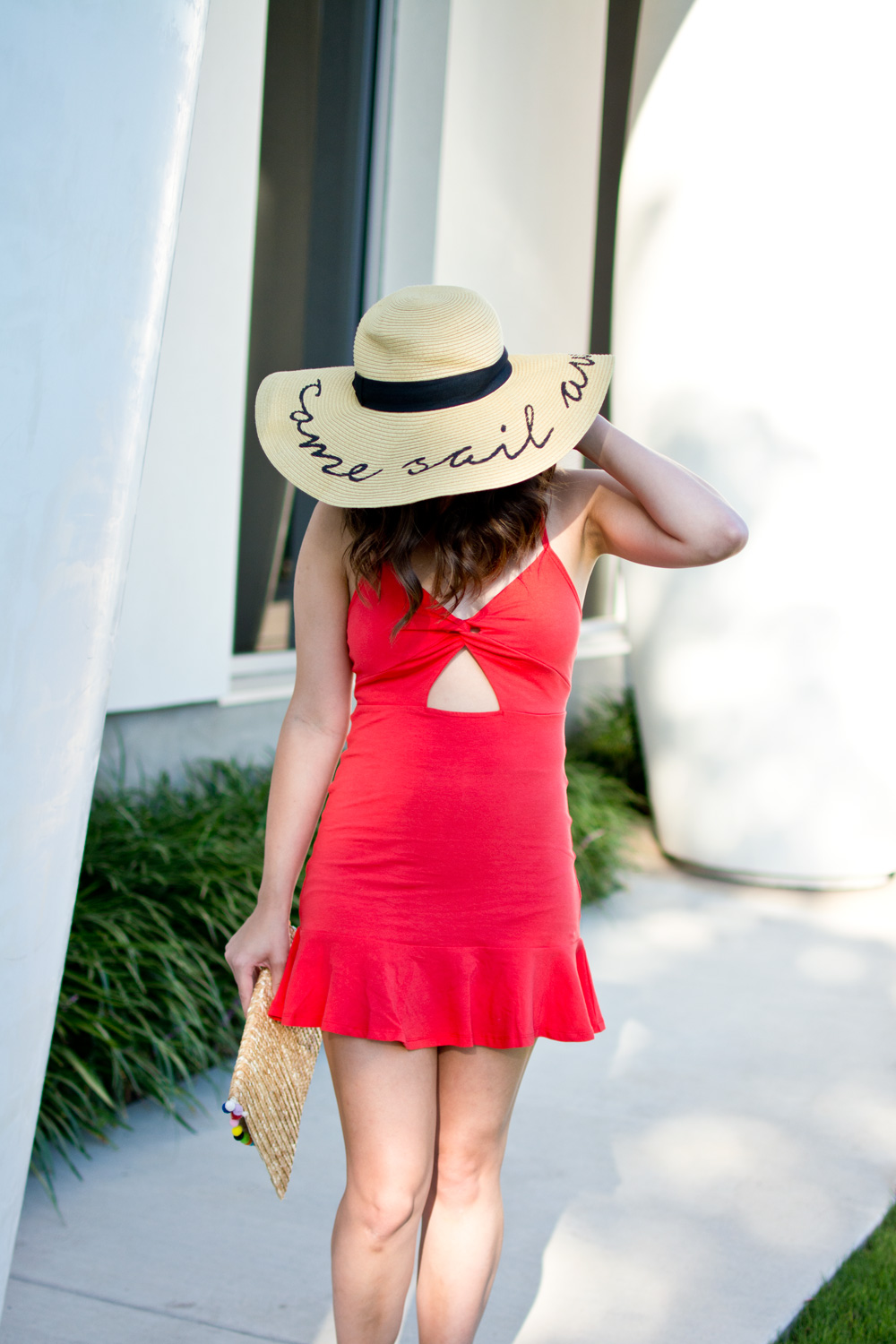 Red Asos sundress with hat and straw clutch