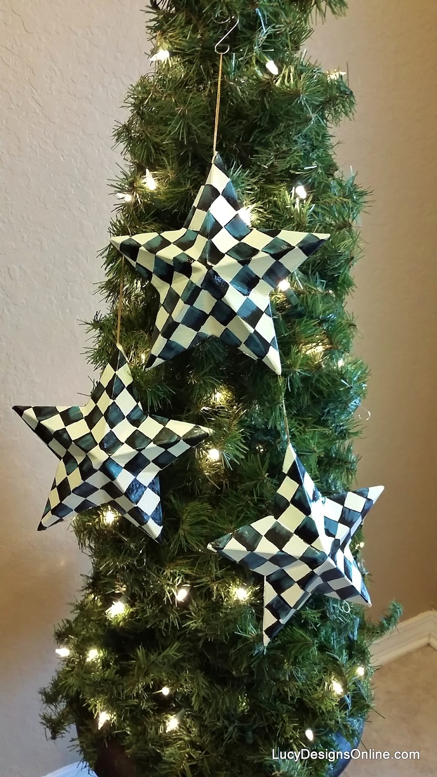 hand painted black and white check ornaments star shape on tomato cage topiary