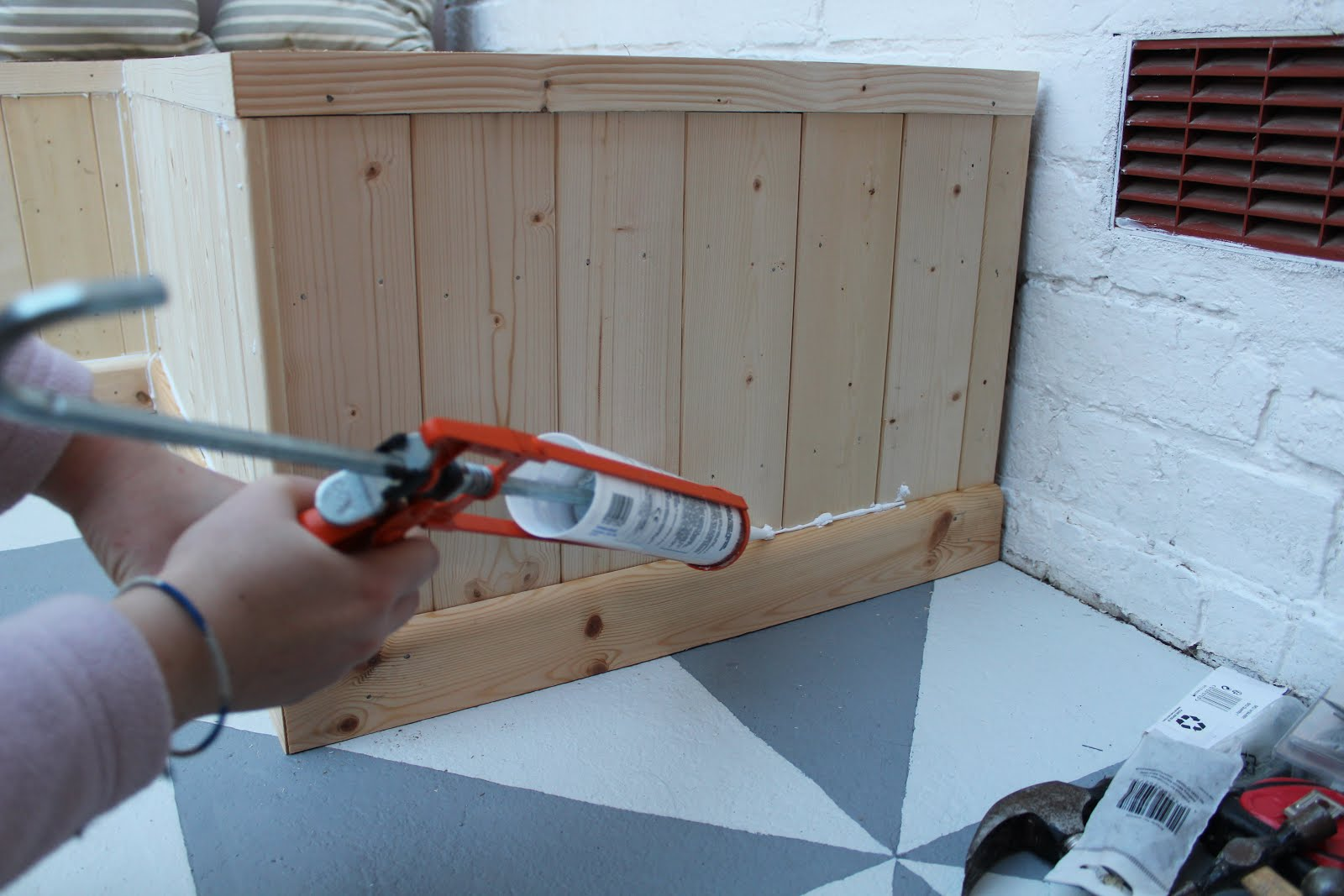 caulking around pallet bench