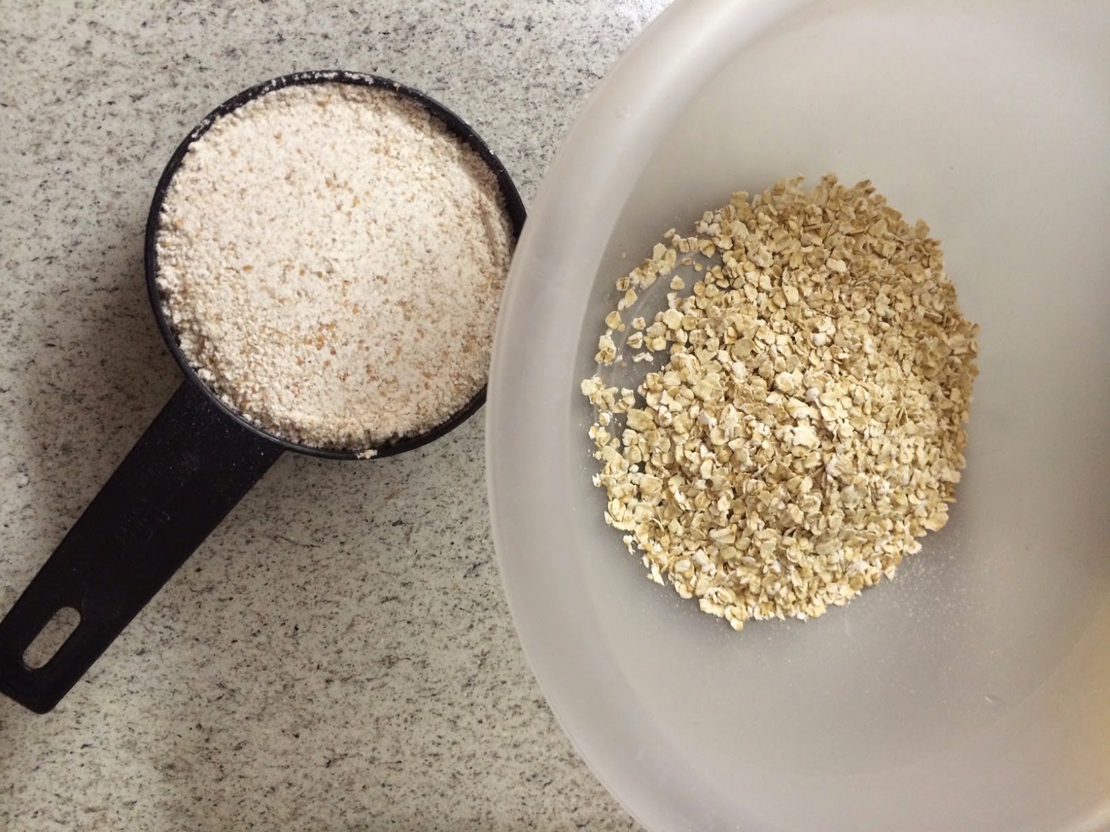 a bowl, measuring cup, and whole wheat flour and oats