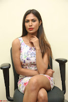 Nishi Ganda stunning cute in Flower Print short dress at Tick Tack Movie Press Meet March 2017 136.JPG