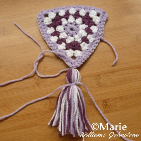 tying yarn decoration to your crochet project banner