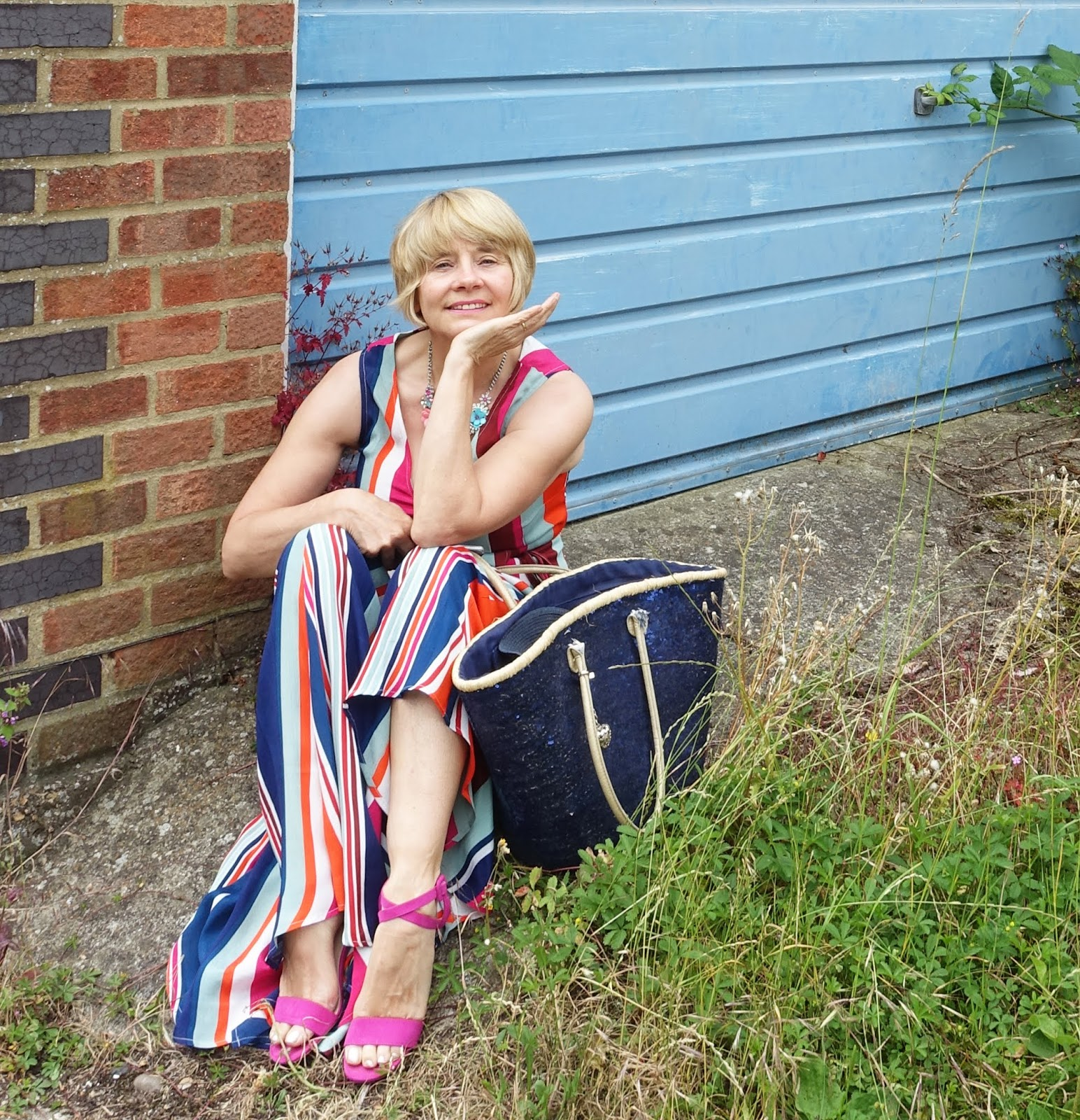Gail Hanlon from over-45s blog Is This Mutton? in a colourful striped maxi dress from Monsoon