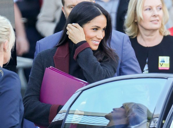 Meghan Markle wore Charcoal black and burgundy double face coat and Sarah Flint Jay tortoiseshell pumps. Prince Harry