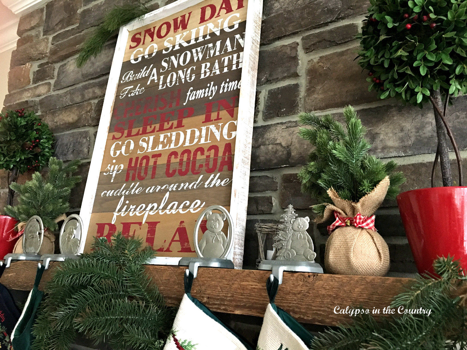 Rustic Christmas Sign on Stone Fireplace