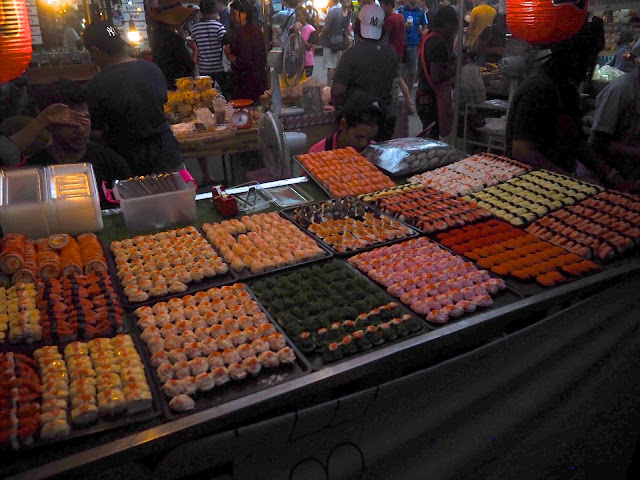Sushi stall at Naka Weekend Market, Phuket, Thailand