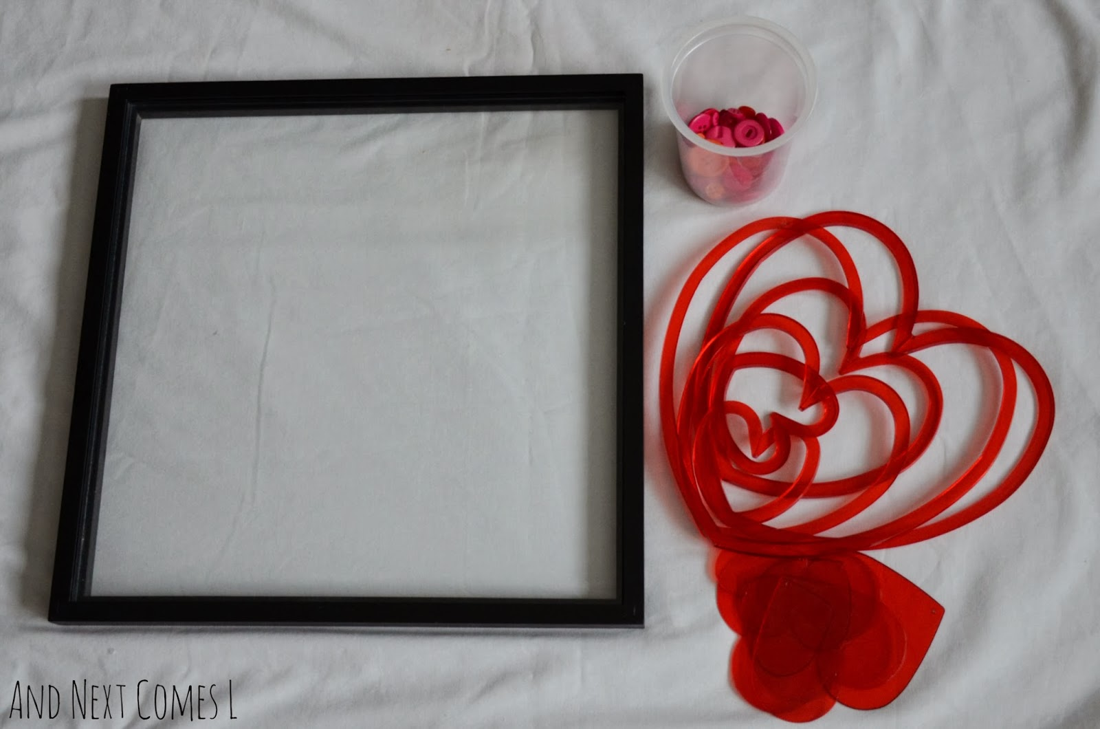 Simple Valentine's themed loose parts play idea for toddlers and preschoolers