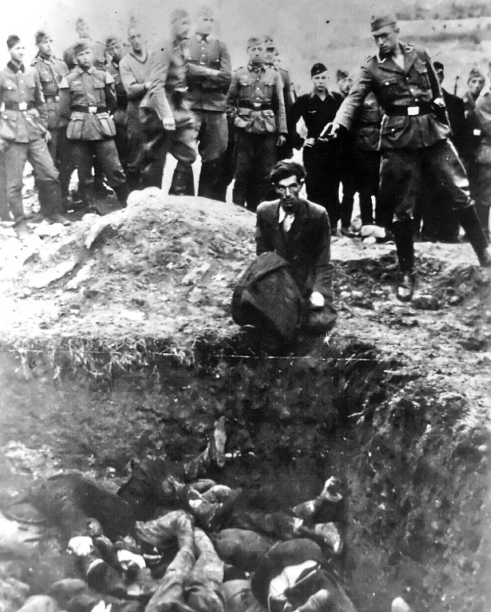 """The last Jew in Vinnitsa"" – Member of Einsatzgruppe D (a Nazi SS death squad) is just about to shoot a Jewish man kneeling before a filled mass grave in Vinnitsa, Ukraine, in 1941. All 28,000 Jews from Vinnitsa and its surrounding areas were massacred."