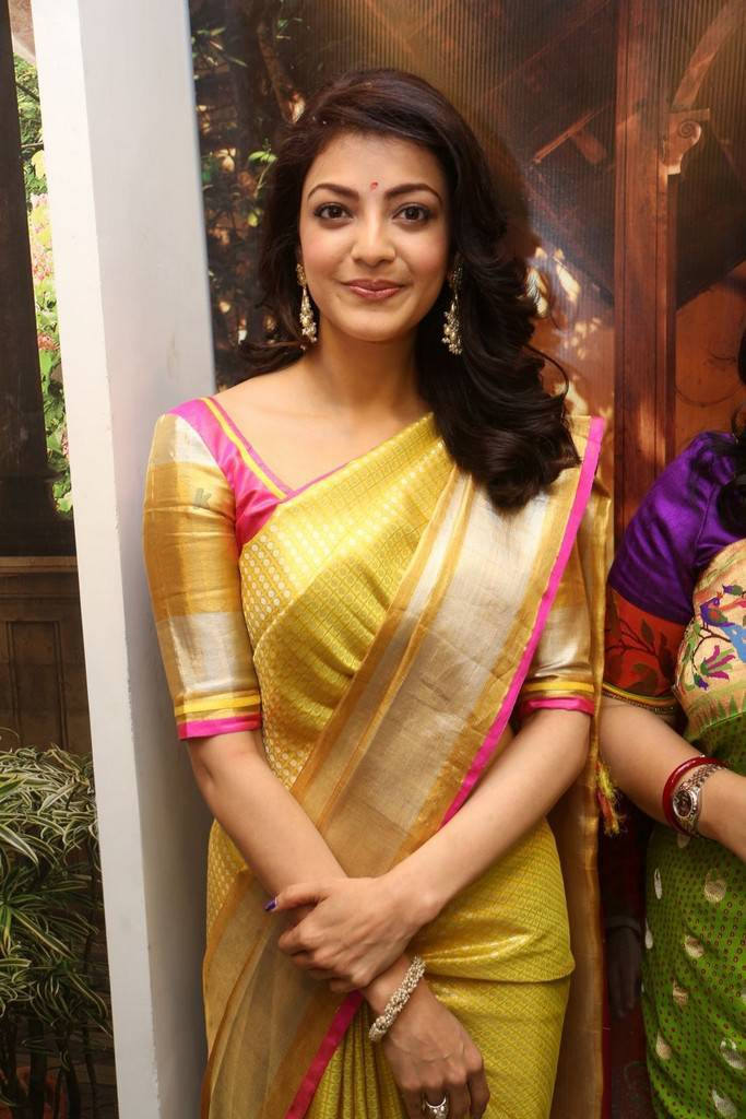 Kajal Aggarwal Stills In Yellow Saree At Designer Store Launch