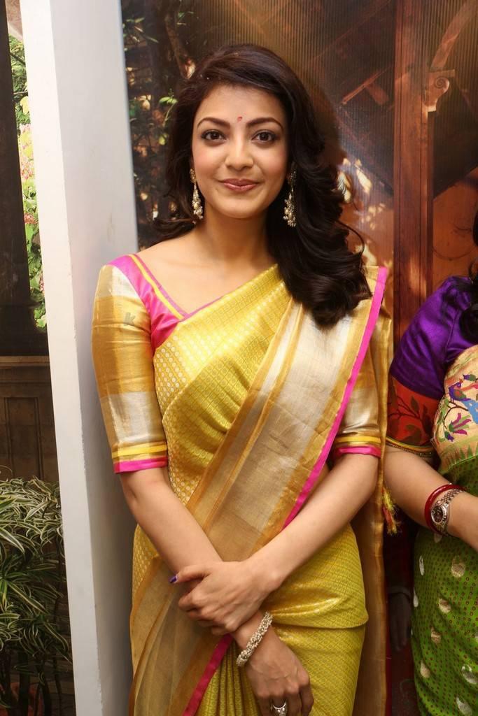 Kajal Aggarwal Stills In Yellow Saree At Designer Store Launch