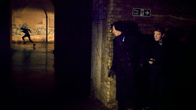 Benedict Cumberbatch and Martin Freeman as Sherlock Holmes and John Watson follow Golem the assassin in BBC Sherlock Season 1 Episode 3 The Great Game
