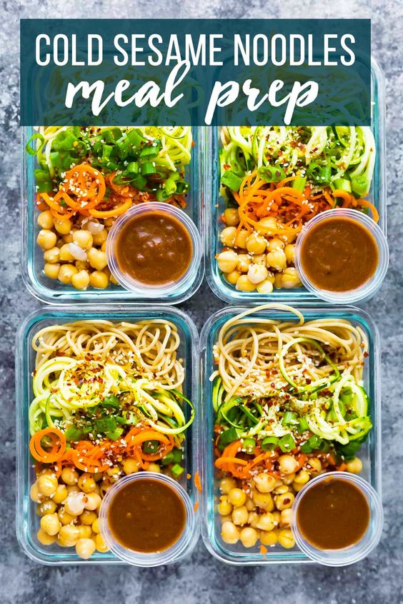 These cold sesame noodle meal prep bowls are the perfect vegan prep ahead lunch: spiralized vegetables tossed with chickpeas and whole wheat spaghetti in a spicy almond butter sauce. #sweetpeasandsaffron #mealprep #vegan #spiralizer
