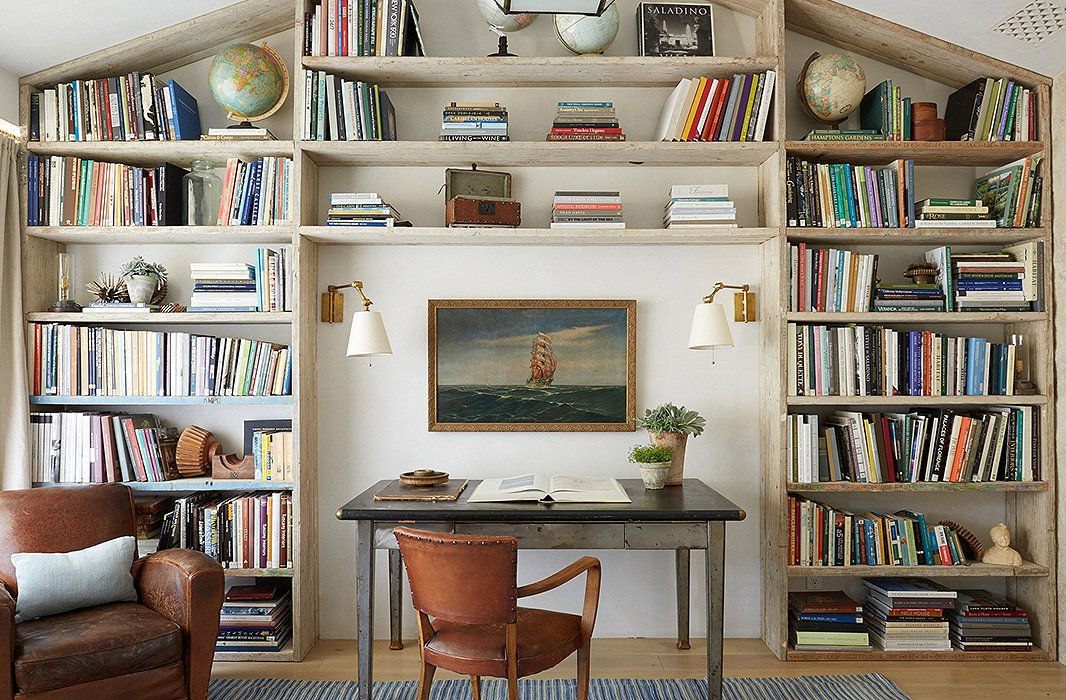 Modern farmhouse den office with wood bookshelves and leather club chairs at Patina Farm