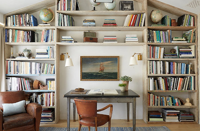 An office with builtin bookshelves at Patina Farm
