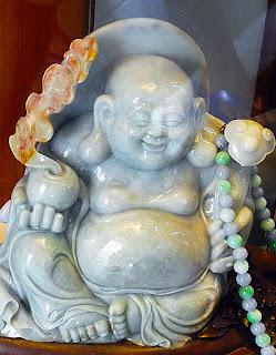 a beautiful carved jade white Buddha