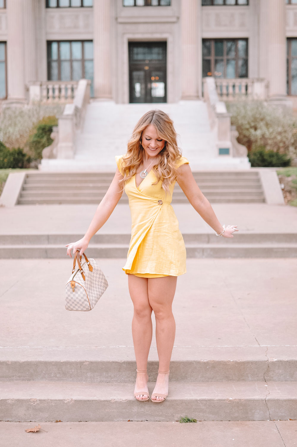 Amanda Martin of OKC blog Amanda's OK wears a yellow wrap dress with flutter sleeves for her Easter dress