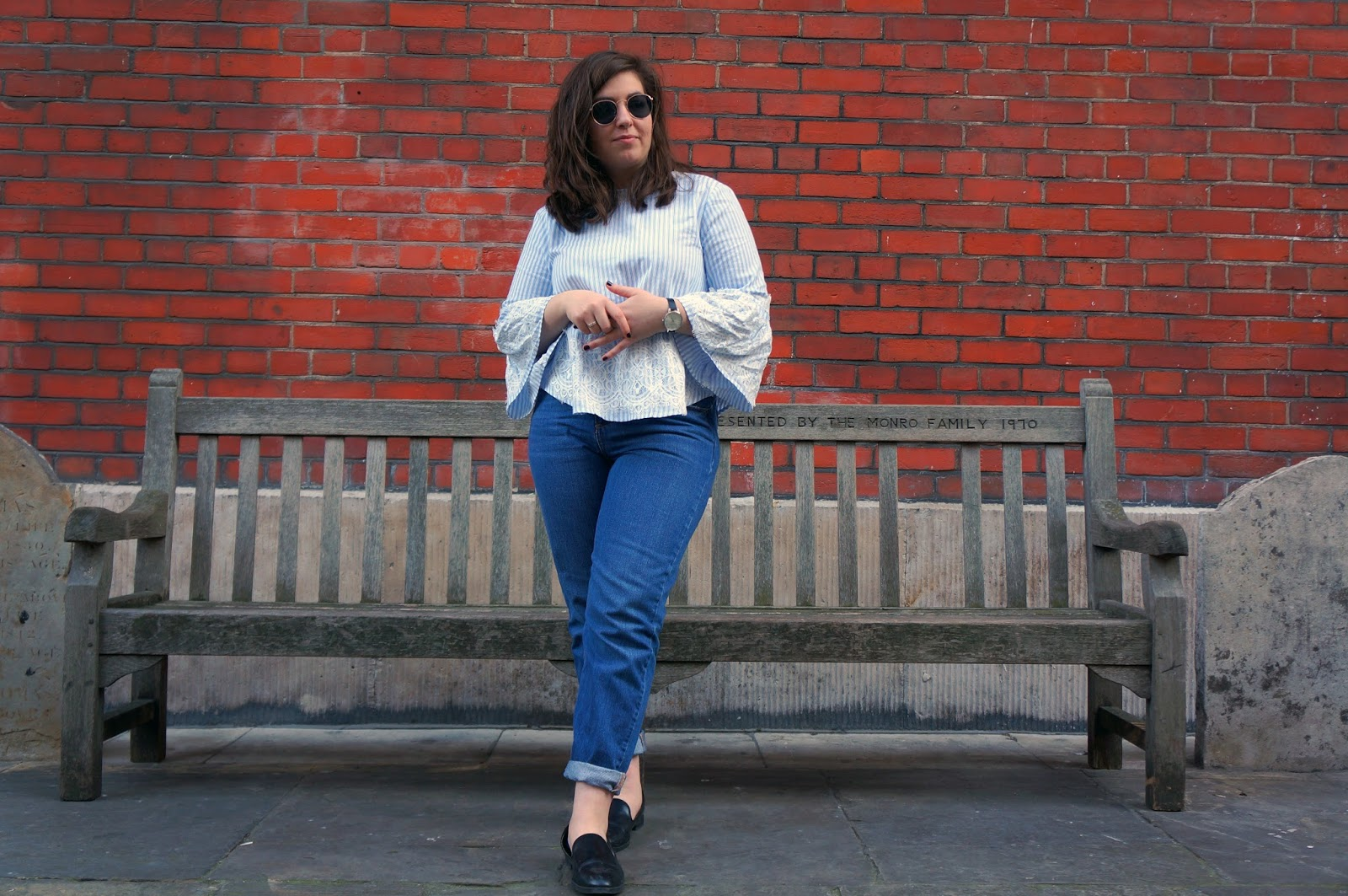 Full outfit; fluted sleeve top styled with straight legged jeans