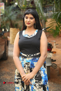 Actress Model Poorni Stills in Floral Long Dress at Silk India Expo Launch  0020.JPG