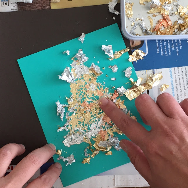 applying the gilding flakes: a mix of silver, gold, copper