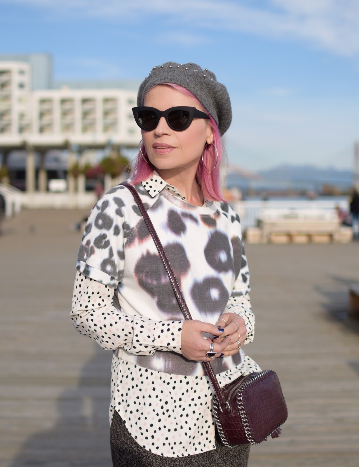 Monika Faulkner outfit inspiration - polka-dot blouse, short-sleeve sweatshirt, beret, cat-eye sunglasses