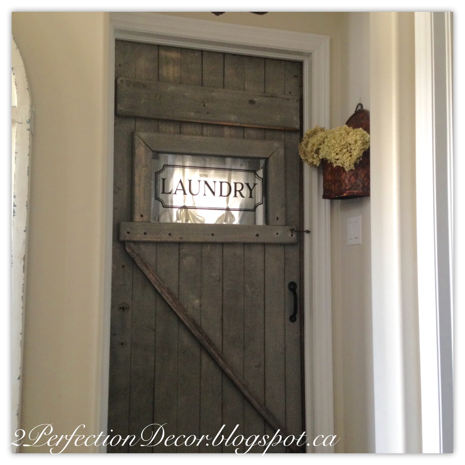 2Perfection Decor: Antique Barn Door as our Laundry room door