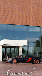 McLaren 12C in front of building