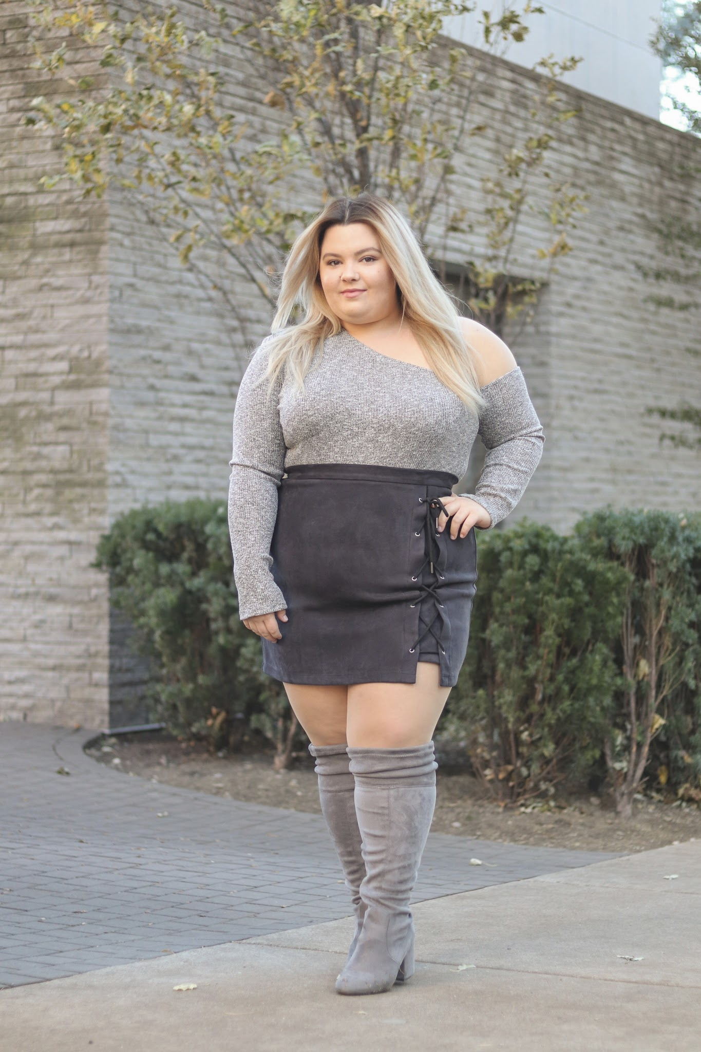 Chicago Plus Size Fashion Blogger Natalie Craig reviews gray suede over the knee boots.