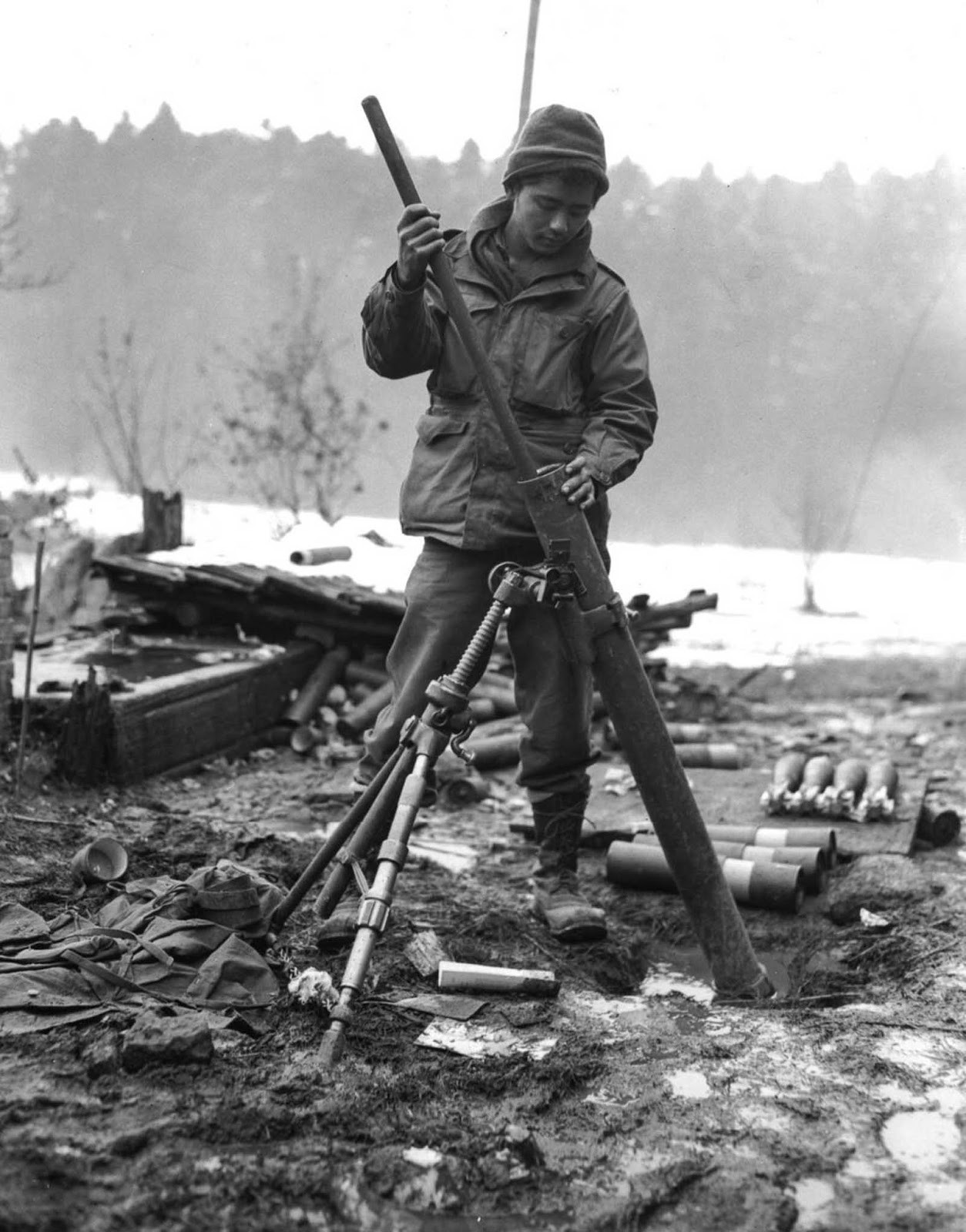 A soldier of the 442nd cleans the barrel of an 81mm mortar near St. Die, France. Nov. 17, 1944.