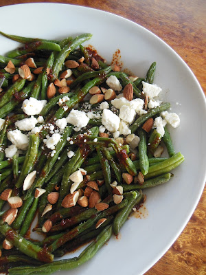 Blistered Green Bean Salad with Smoked Paprika Vinaigrette Feta Cheese and Chopped Almonds. The perfect first coarse or side dish.