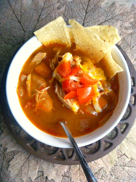 Slow Cooker Lighter King Ranch Chicken Soup:  Imagine a bowl of steaming hot and hearty soup that is filled with shredded chicken, peppers, tomatoes, and southwestern flavors that pack a huge punch! - Slice of Southern