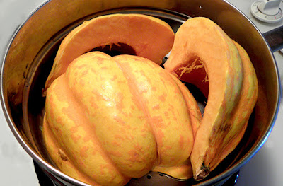 cut up acorn squash in steamer