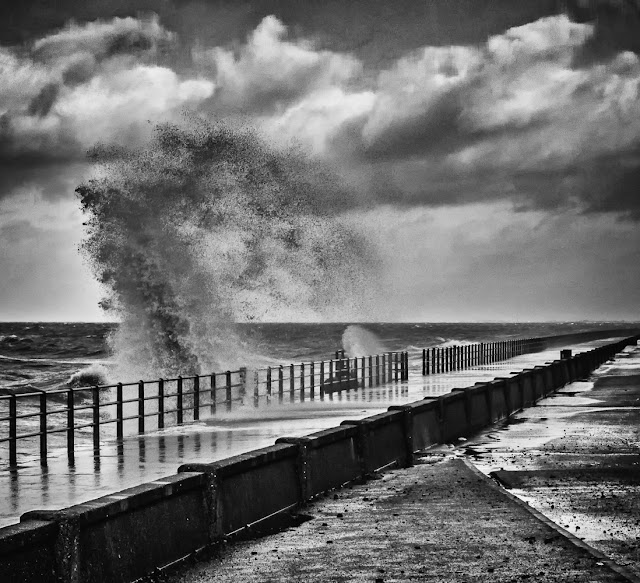 Photo of a towering wave whipped up by high winds by Maryport Promenade