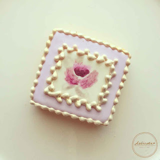 natural food colouring painted purple rose cookies with gold painting